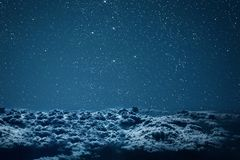 Backgrounds night sky with stars and clouds. stock photography