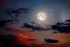 Backgrounds night sky. With stars and moon and clouds. wood. Elements of this image furnished by NASA Stock Photos