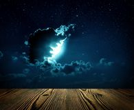 Backgrounds night sky with stars,. Moon and clouds. wood floor Royalty Free Stock Photo