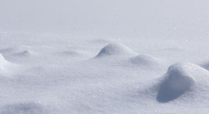 Backgrounds - Small Snowy Landscape. Image showing a small snow landscape with mini mounds of snow in focus royalty free stock photos