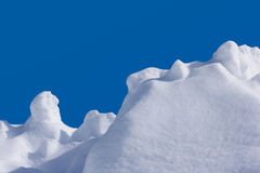 Backgrounds - Snow with Clear Blue Sky. Image of snow with a nice even bright blue sky in the background royalty free stock photos