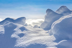 Backgrounds - Snow Path. Small path within a natural formation of snow with a beautiful bright blue sky in the background stock image