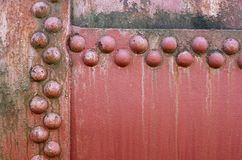 Old riveted metal wall surface royalty free stock image