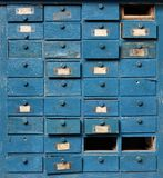 Old blue wooden cabinet with drawers Royalty Free Stock Photo