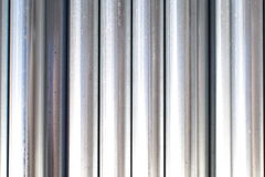 Metal tubes. Backgroune of many metal tubes close up Stock Image