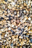 Backgroung av små stenar Arkivfoton