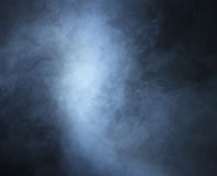 Backgroung image of a deep blue smoke and light Stock Photos