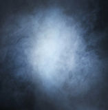 Backgroung image of a deep blue smoke and light Royalty Free Stock Photo