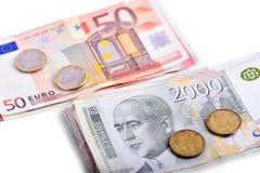 Backgrounnnd van bankbiljetten en muntstukken Stock Foto