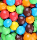 Backgroynd of chocolate balls in colorful glaze. Royalty Free Stock Photo