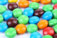 Backgroynd of chocolate balls in colorful glaze. Stock Photos