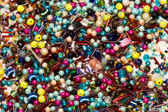 A backgruond of all sorts of jewelery peaces. On it Stock Photography