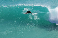 Backhand wave. Aerial view of Surfer carving backhand at the Hoek near Cape Town Stock Image