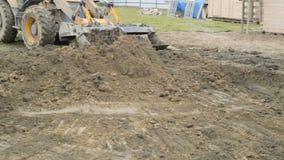 Backhoe ładowacz robi pracie przy budową zbiory