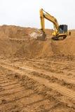 Backhoe на следе песка Стоковые Изображения
