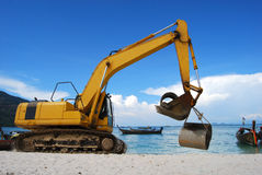 Backhoe. Is holding concrete water pipe on the beach, Lipeh island, Thailand Royalty Free Stock Photos