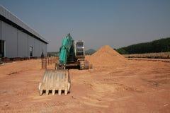 The backhoe. On break between construction stock images