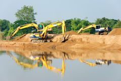 Backhoe. Backhoe was digging sand at the edge of the river stock photography