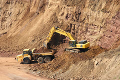 Backhoe And Dumptruck At Rock Quarry Royalty Free Stock Photo