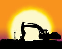 Backhoe with big yellow sunset. And farm setting with copy space Royalty Free Stock Photos