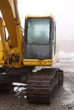 Backhoe cabin on wet and foggy day Stock Images