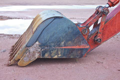 Backhoe Claw bucket. The Backhoe Claw bucket with orange arm Royalty Free Stock Photography