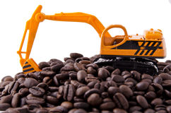 Backhoe and coffee beans Stock Image