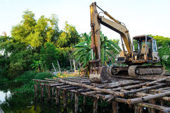 Backhoe construction the landslide protection. Near canal stock image
