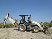 Backhoe at a construction site Royalty Free Stock Photos