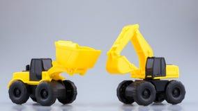 Backhoe da construção e brinquedo resistentes do trator Foto de Stock Royalty Free
