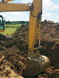 Backhoe digging a hole for house construction Royalty Free Stock Photo