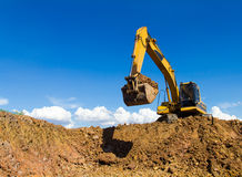 Backhoe digging Royalty Free Stock Images