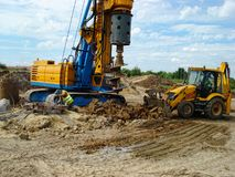Backhoe and drilling machinery. Earth Royalty Free Stock Photos