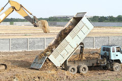 Backhoe and dump truck Stock Photo