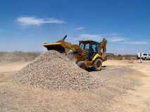 Backhoe Dumping Gravel Royalty Free Stock Images