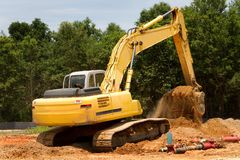 Backhoe Earthmover. Backhoe machine uses shovel scooper to excavate and move dirt Royalty Free Stock Photos