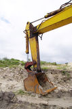 Backhoe excavator in sand quarry Royalty Free Stock Photography