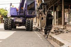 Backhoe industrial, perfuração movente da escavadora Imagem de Stock Royalty Free
