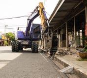 Backhoe industrial, perfuração movente da escavadora Fotos de Stock