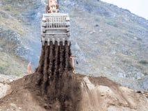 Backhoe lader die in grondverzet werken Stock Fotografie