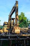 Backhoe and landslide protection. Backhoe is building landslide protection near thr canal royalty free stock image