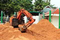 Backhoe loader. Clearing land  for  construction Royalty Free Stock Photography