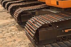 Backhoe loader. The backhoe loader on a concrete floor stock photos