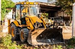 Backhoe Loader In Construction Area Stock Images