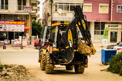 Backhoe Loader In Construction Area Stock Photo