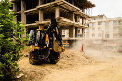 Backhoe Loader In Construction Area Stock Photos