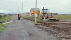 Backhoe loader digging soil. Construction site stock footage