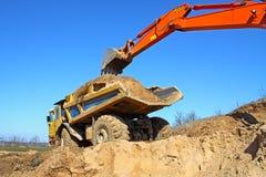 Backhoe loader loading dumper Royalty Free Stock Photography