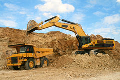 Backhoe loader loading dumper Royalty Free Stock Photo