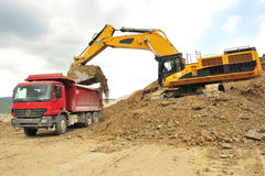 Backhoe loader loading truck Royalty Free Stock Photography